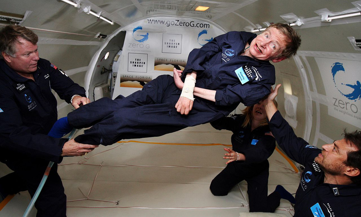 Stephen Hawking (center) enjoys zero gravity during a flight aboard a modified Boeing 727 aircraft. At the celebration of his 65th birthday on January 8, 2007, Hawking announced his plans for a zero-gravity flight to prepare for a sub-orbital space flight in 2009 on Virgin Galactic's space Service, 2007-04-26. Wikimedia Commons